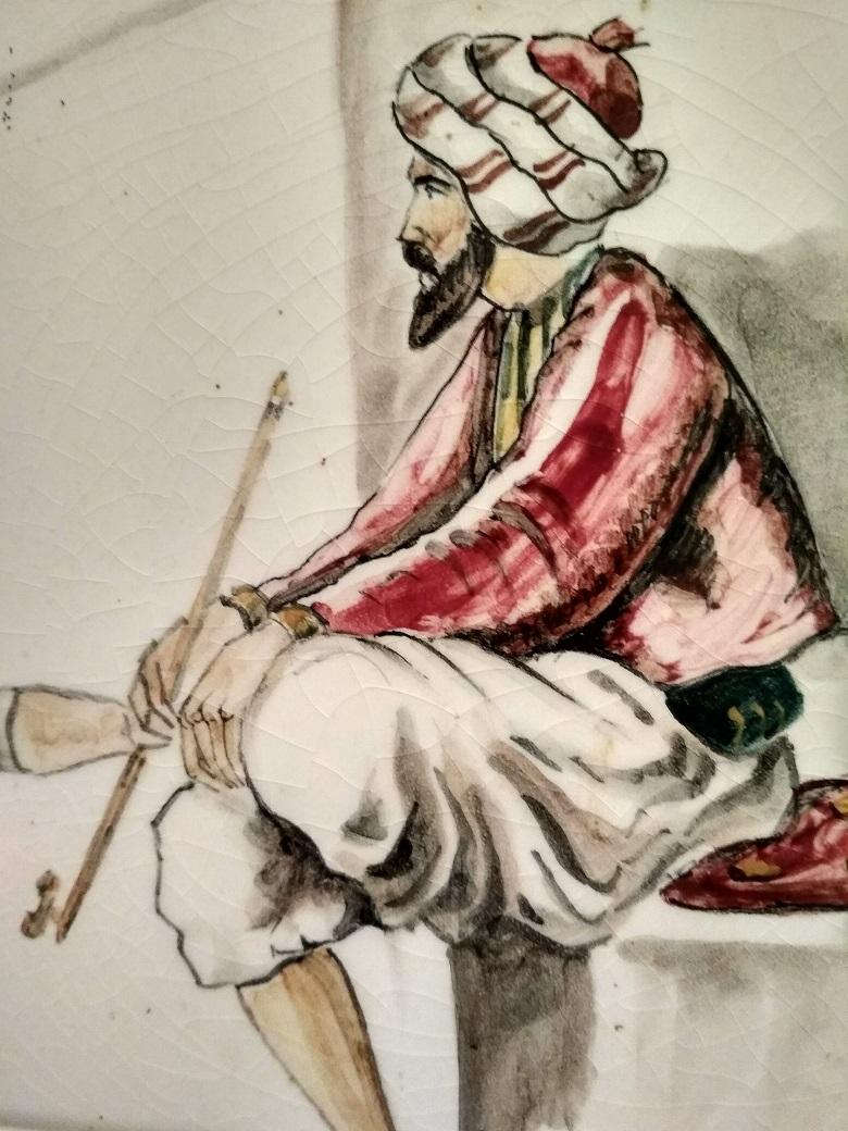 Immagine di personaggio mediorientale con il vizio del fumo; questa è una de le 5 cose da non fare.